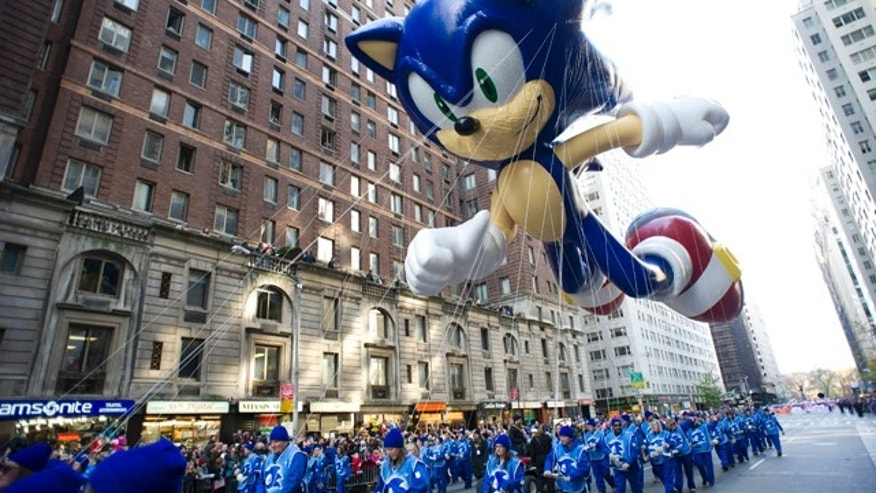 FILE - In this Nov. 22, 2012, file photo, handlers keep a tight rein on the Sonic the Hedgehog balloon as it travels the route of the Macy's Thanksgiving Day Parade in New York. Macyâs says it is closely monitoring the weather after recent forecasts predicted wind gusts up to 30 mph on Thanksgiving morning during the department storeâs upcoming Thanksgiving Day Parade. Based on New York City guidelines, no giant balloons will be operated if the wind gusts exceed 34 mph. (AP Photo/Charles Sykes, File)