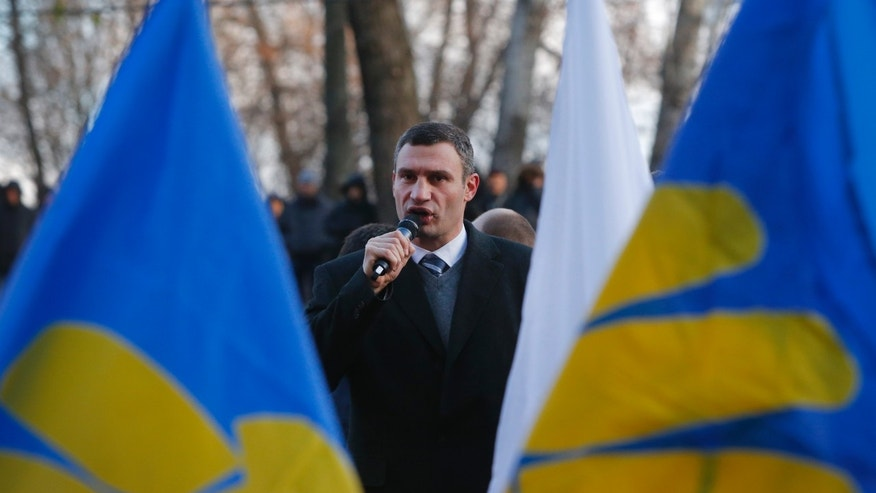 Lawmaker and chairman of the Ukrainian opposition party Udar (Punch), WBC heavyweight boxing champion Vitali Klitschko delivers a speech during a rally in front of the Ukrainian Cabinet of Ministers in Kiev, Ukraine, Wednesday Nov. 27, 2013, as round-the-clock opposition protests continue in support of European Union integration. (AP Photo/Sergei Grits)