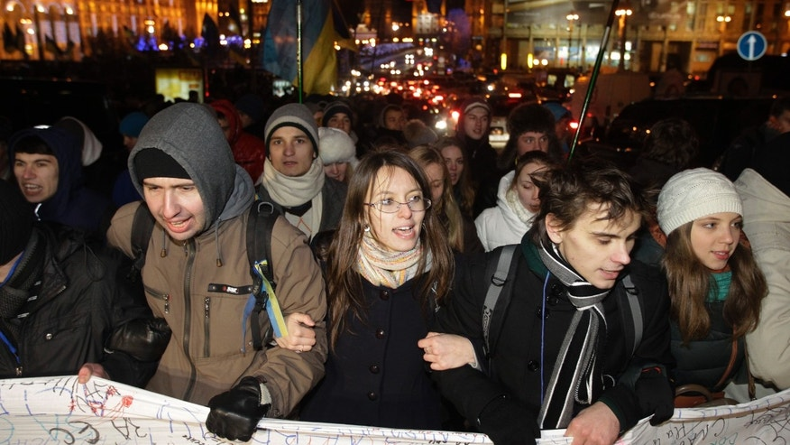 Ukrainian students shout slogans during a gathering to support European Union integration at Independence Square in Kiev, Ukraine, Wednesday Nov. 27, 2013. (AP Photo/Sergei Chuzavkov)