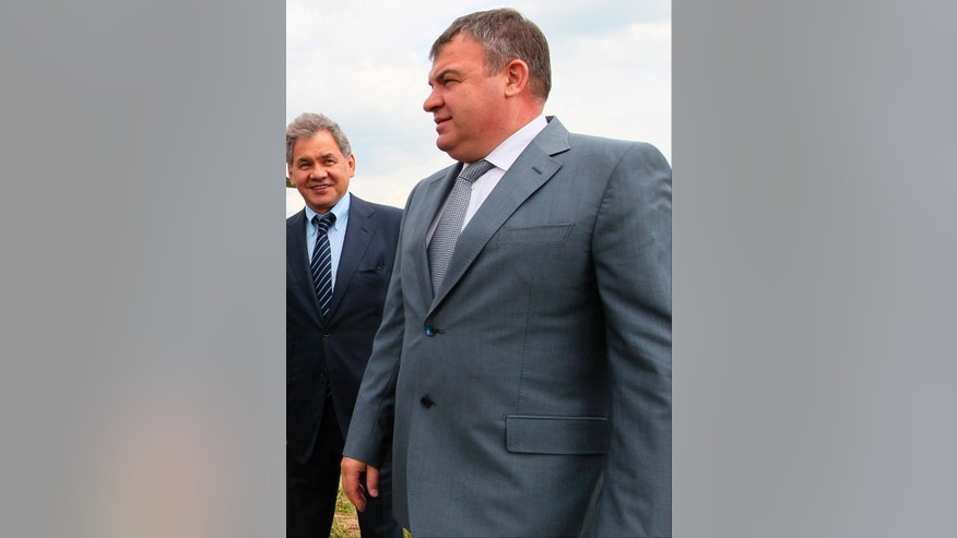 FILE - This Tuesday, June 26, 2012 file photo shows then Defense Minister Anatoly Serdyukov, right, and then Moscow region governor Sergei Shoigu are photographed together at the village of Petrovskopye, Moscow region. Russia's main investigative agency has filed charges against Serdyukov Thursday, Nov. 28, 2013,  accusing him of using servicemen and government funds to build a road to a vacation home and do landscaping work on the property. If convicted, Serdyukov could face up to five years in prison. (AP Photo/RIA Novosti, Yekaterina Shtukina, Government Press service, File)