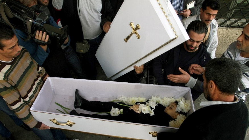 This Tuesday, Nov. 12, 2013 photo shows mourners carrying the coffin of a child killed in a mortar strike at the the Yuhana al-Dimashqi School in Damascus, Syria. They fall randomly, often during rush hour, smashing into schools, businesses, churches and homes and leaving a trail of death and terror in their wake. As President Bashar Assad's forces press ahead with a crushing offensive, rebels are increasingly hitting back by sending volleys of mortar shells into central Damascus. Many residents now barricade themselves at home and schools are half empty. Businessmen say sales have plunged, because people no longer dare to go out.(AP Photo)