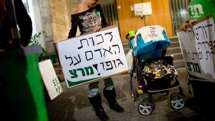 Nov. 28, 2013: Israelis protest in support of a woman who refuses to have her son circumcised, in Tel Aviv, Israel.