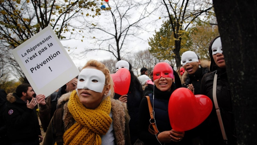 "French sex workers demonstrate next to the French Assembly in Paris, Friday, Nov. 29, 2013. In 2015. They protested against a proposal to penalise clients caught in the act of soliciting a prostitute. The board reads : ""Repression is not prevention"".  (AP Photo/Christophe Ena)"
