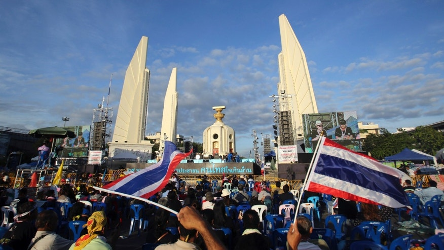 Anti-government protesters gather in front of the Democracy Monument during a rally in Bangkok, Thailand, Friday, Nov. 29, 2013. Thailand's prime minister begged protesters Thursday to call off their sustained anti-government demonstrations and negotiate an end to the nation's latest crisis.(AP Photo/Sakchai Lalit)