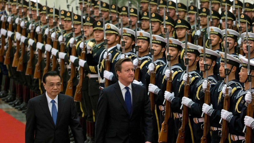 British Prime Minister David Cameron, center, attends a welcome ceremony with Chinese Premier Li Keqiang, at the Great Hall of the People in Beijing, China, Monday, Dec. 2, 2013. (AP Photo/Ng Han Guan)