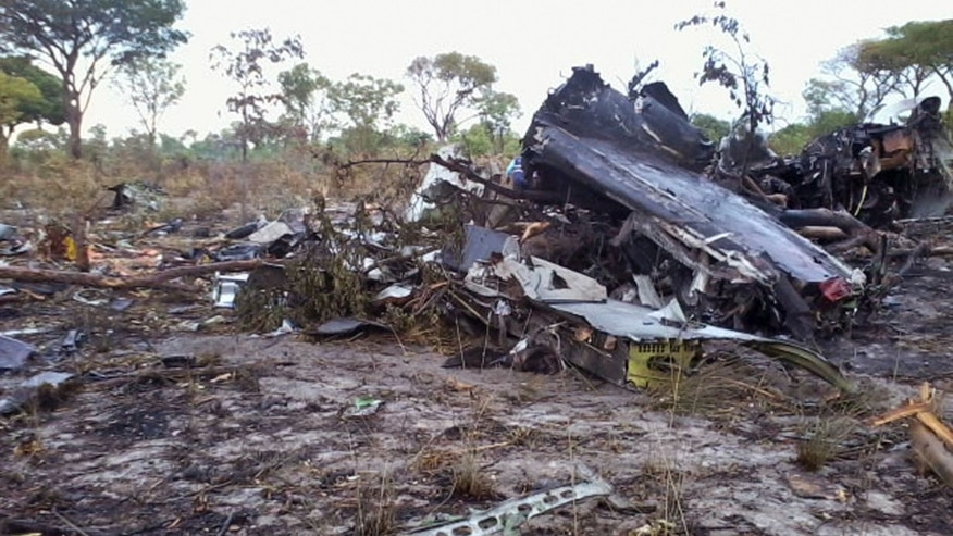 This Saturday, Nov. 30, 2013 photo, shows remains of parts of a Mozambique Airlines plane which crashed in the Bwabwata National Park, Namibia. The Mozambique Airlines plane carrying 33 people crashed, killing all on board, officials said Saturday. The plane crashed in the Namibian national park near the border with Angola and there were no survivors, Namibian police and Mozambican authorities said. An investigation of the cause was underway, and teams of experts headed to the scene. (AP Photo/NAMPA, Olavi Haikera)