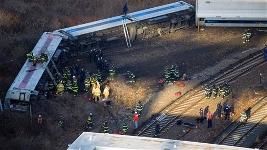 "First responders gather at the derailment of a Metro North passenger train in the Bronx borough of New York Dec. 1, 2013  The Fire Department of New York says there are ""multiple injuries"" in the  train derailment, and 130 firefighters are on the scene. Metropolitan Transportation Authority police say the train derailed near the Spuyten Duyvil station. (AP Photo/Craig Ruttle)"