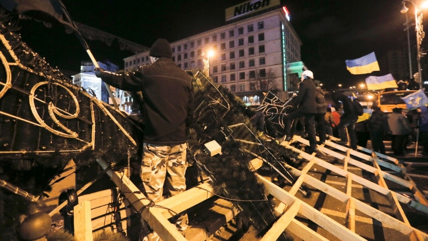 Dec. 2, 2013 - Protesters stand on the barricade and expect a police attack  in Independent Square in Kiev, Ukraine.  A protest by about 300,000 Ukrainians angered by their government's decision to freeze integration with the West turned violent Sunday, when a group of demonstrators besieged the president's office and police drove them back with truncheons, tear gas and flash grenades. Dozens were injured.