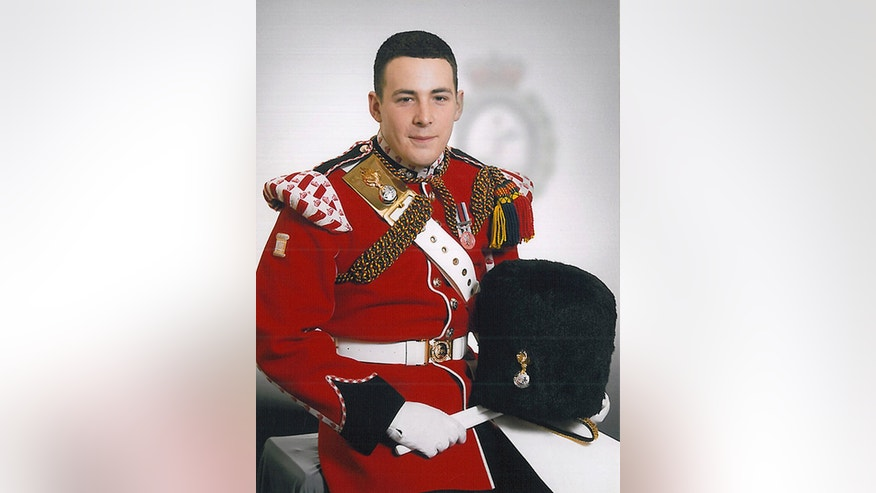 FILE - This undated file image released on Thursday May 23, 2013 by the British Ministry of Defence, shows Lee Rigby, who was attacked and killed by two men in the Woolwich area of London on May 23, 2013. A prosecutor outlined the chilling tactics used to nearly decapitate an unarmed British soldier on a London street, as two men went on trial Friday Nov. 29, 2013 in connection with the suspected extremist attack. (AP Photo/MOD, File)