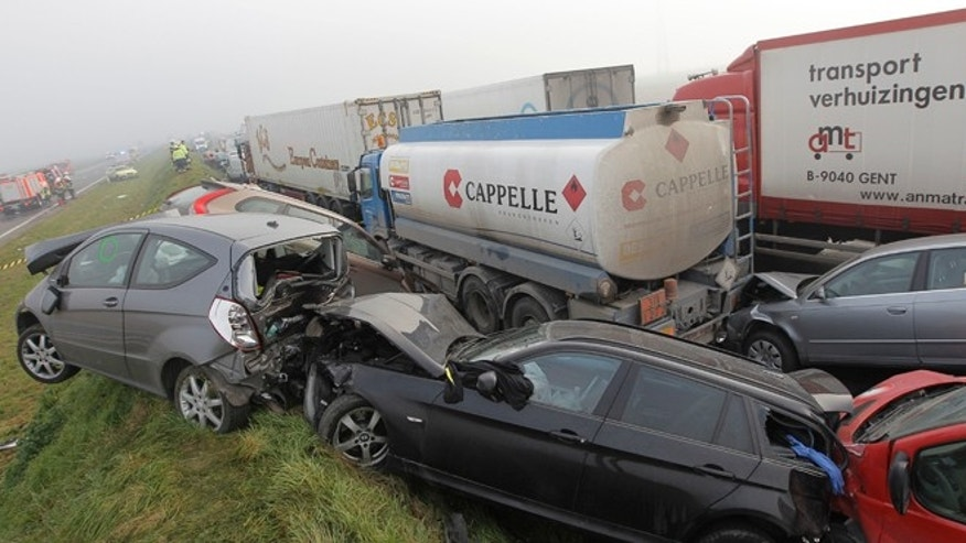 Dec. 3, 2013: Crashed cars sit on top of a shoulder on the A19 highway in Zonnebeke, western Belgium.