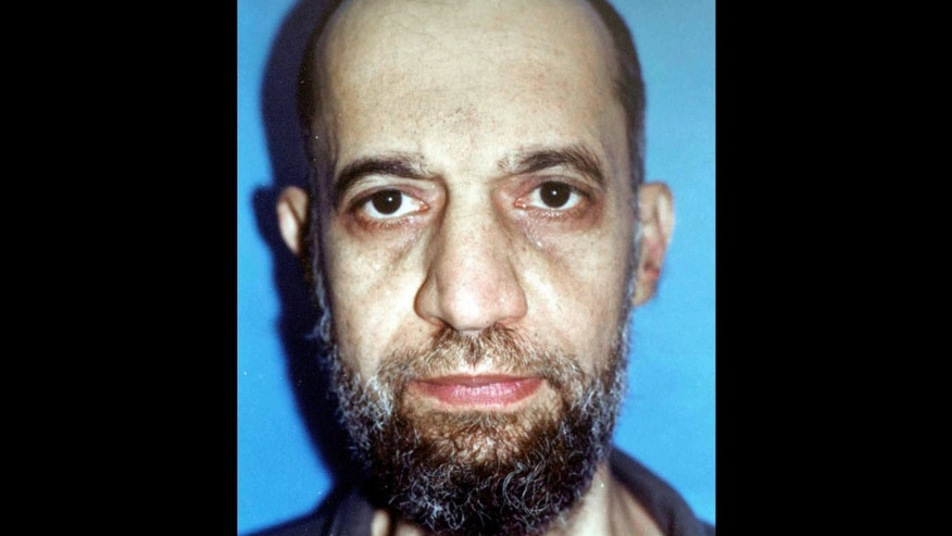 FILE - In this undated file photo, Mohammed al-Zawahri is seen in police custody in Cairo, Egypt. The brother of al-Qaida leader Ayman al-Zawahri has sanctioned violence against the West in retaliation from French-led campaign against militants in Mali. During his year as president, Mohammed Morsi cultivated ties with Islamic radicals, making them a key support for his rule by pardoning dozens of jailed militants, restraining the military from an all-out offensive on jihadis in Sinai and giving their hard-line sheiks a platform to spread their rhetoric. Now with Morsi ousted and imprisoned, investigators are looking into possibly putting him on trial for links to jihadis, accusing him and his Muslim Brotherhood of being behind a wave of violence by Sinai-based militants in retaliation for the July 3 military coup that removed the Islamists from power, military and security officials say. The officials said investigators are also looking into a series of pardons Morsi gave to militants.The generals who ran Egypt for nearly 17 months after Hosni Mubarak's ouster also released militants from jail, including the brother of al-Qaida leader Ayman al-Zawahri, Mohammed.(AP Photo/Asharq al-Awsat, File)