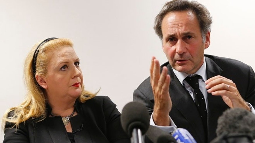 Dec. 3, 2013: Suha Arafat, left, flanked with her French Lawyer Pierre Olivier Sur, attend a press conference in Paris, France on Tuesday.