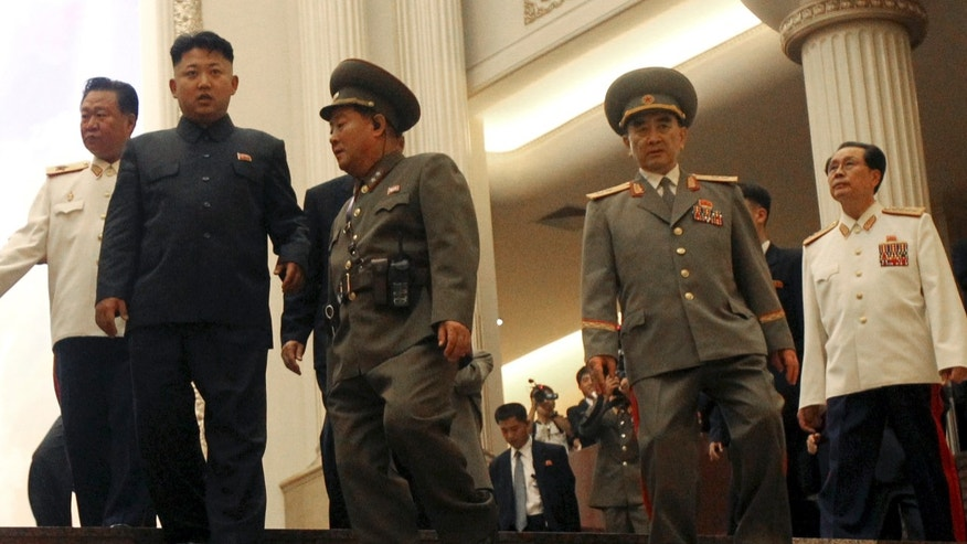 FILE - In this Saturday, July 27, 2013 file photo, North Korean leader Kim Jong Un, second left, flanked by Yang Hyong Sop, second right, vice president of the Presidium of North Korea's parliament, his uncle Jang Song Thaek, right, and Choe Ryong Hae, vice Marshal, left, as he tours the newly opened Fatherland Liberation War Museum, as part of celebrations for the 60th anniversary of the Korean War armistice in Pyongyang, North Korea. Two South Korean lawmakers say they were told by intelligence officials that two associates of North Korean leader Kim Jong Un's powerful uncle Jang were executed last month. They say the uncle has not been seen in public since then and may have been dismissed. There was no way to independently confirm the report about Jang. (AP Photo/Wong Maye-E)
