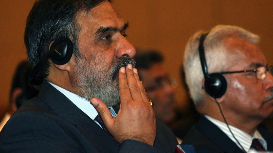 India's Trade Minister Anand Sharma, left, listens during the plenary session of the Ninth Ministerial Conference of the World Trade Organization (WTO) in Bali, Indonesia, Wednesday, Dec. 4, 2013. (AP Photo/Firdia Lisnawati)