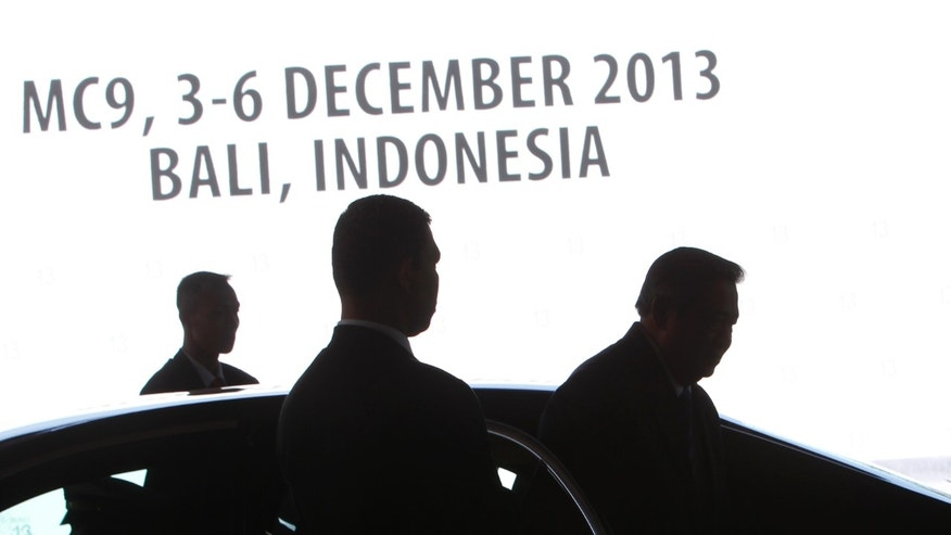 Indonesia's President Susilo Bambang Yudhoyono, right, arrives for the opening of the Ninth Ministerial Conference at the World Trade Organization in Bali, Indonesia, Tuesday, Dec. 3, 2013.  (AP Photo/Edgar Su, Pool)