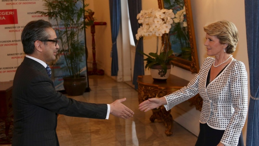 Australian Foreign Minister Julie Bishop, right, is greeted by his Indonesian counterpart Marty Natalegawa prior to their meeting in Jakarta, Indonesia, Thursday, Dec. 5 2013. (AP Photo/Tatan Syuflana)