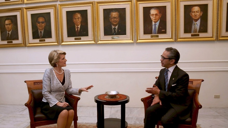 Australian Foreign Minister Julie Bishop, left, talks with Indonesian counterpart Marty Natalegawa during their meeting in Jakarta, Indonesia, Thursday, Dec. 5 2013. (AP Photo/Tatan Syuflana)
