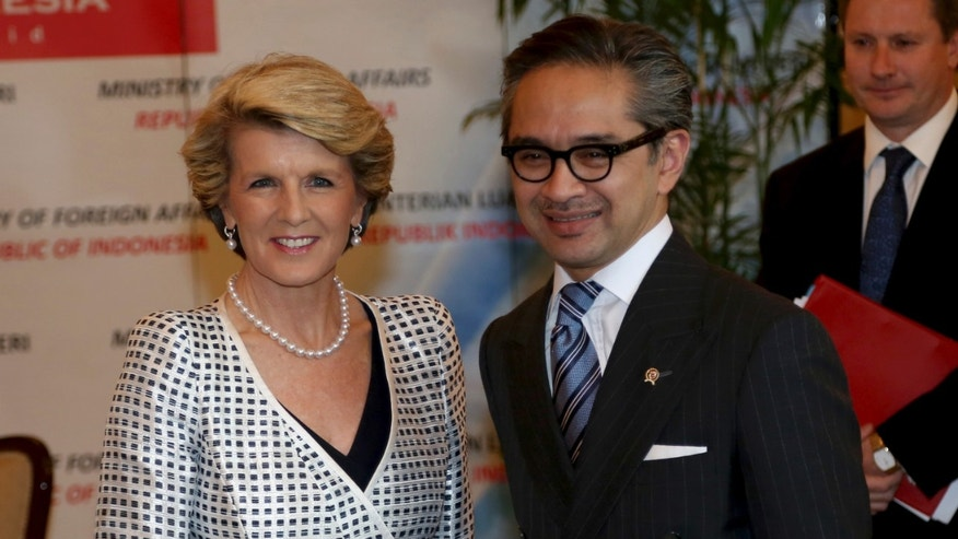 Australian Foreign Minister Julie Bishop, left, is greeted by his Indonesian counterpart Marty Natalegawa prior to their meeting in Jakarta, Indonesia, Thursday, Dec. 5 2013. (AP Photo/Tatan Syuflana)
