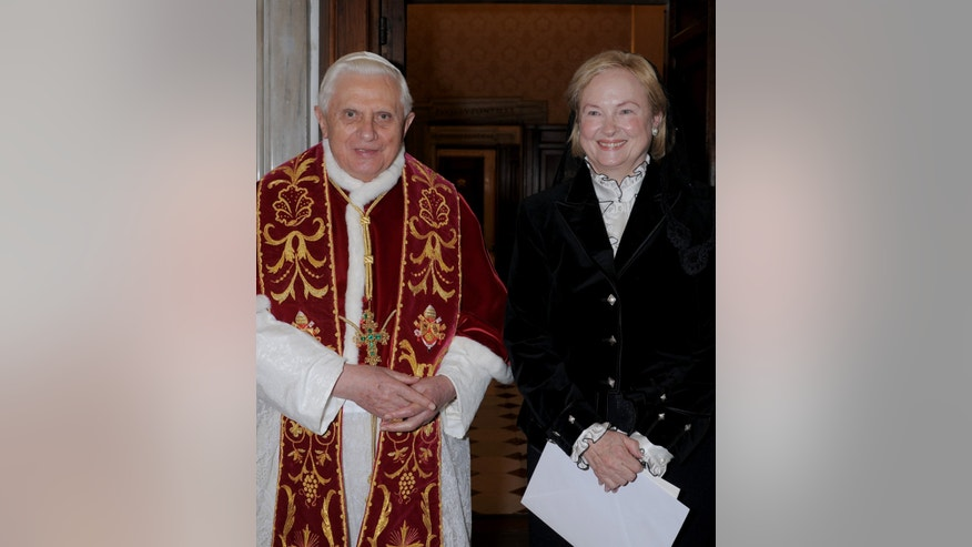 FILE - In this Feb. 29, 2008 file photo released by the Vatican's L'Osservatore Romano newspaper, Pope Benedict XVI, left, looks on with Washington's new ambassador Mary Ann Glendon, before receiving her credentials at the Vatican. Thomas Williams, the onetime public face of the disgraced Legion of Christ religious order who left the priesthood after admitting he fathered a child, is getting married this weekend to the child's mother, The Associated Press has learned Thursday, Dec. 5, 2013. The bride is the daughter of former U.S. Ambassador to the Holy See Mary Ann Glendon, the highest-ranking woman at the Vatican. (AP Photo/L'Osservatore Romano, ho, files)