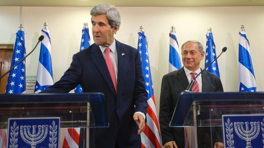 U.S. Secretary of State John Kerry, left, retrieves his notes from the podium after giving a joint statement with Israeli Prime Minister Benjamin Netanyahu at the prime minister's office in Jerusalem, Thursday, Dec. 5, 2013. Kerry is visiting Jerusalem and Ramallah to have the Israeli-Palestinian peace talk and to consult Israeli officials about Iran. (AP Photo/Pablo Martinez Monsivais, Pool)