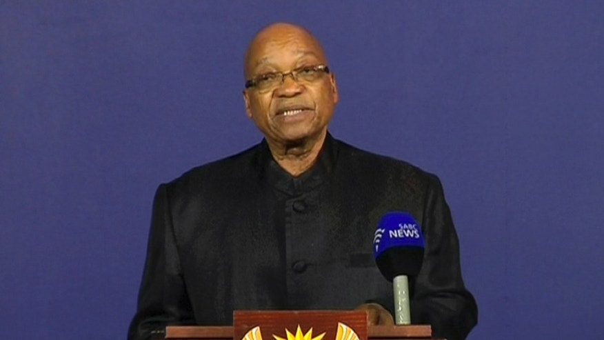 "In this image from live TV, President of South Africa Jacob Zuma announces the death of former South African President Nelson Mandela, to the media Thursday Dec. 5, 2013, from a podium in Pretoria, South Africa.  Zuma announced Thursday that former President Nelson Mandela has died aged 95, Zuma says ""we've lost our greatest son."" (AP Photo/SABC pool)"