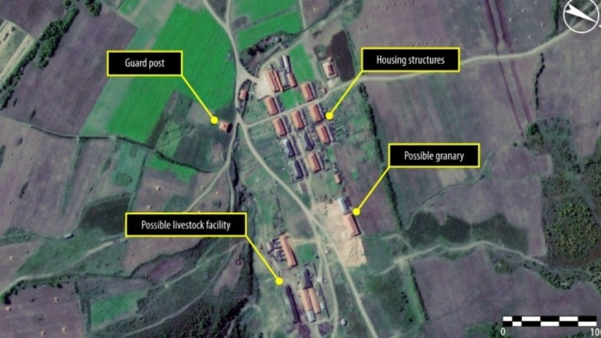Sept. 23, 2011: (BEFORE) This satellite image shows a village in the northern part of North Korean political Camp 16 near Hwaseong in North Hamgyong province.