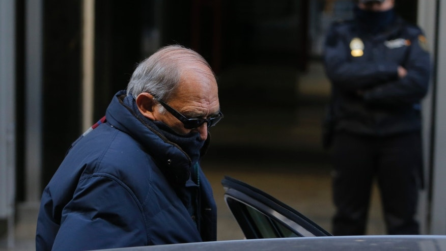 Former member of the security forces of the Franco dictatorship ex-Guardia Civil Jesus Munecas Aguilar, foregrounde, leaves the Supreme Court after appearing before a judge for preliminary extradition proceedings, in Madrid, Spain, Thursday, Dec. 5, 2013.  Two former Spanish security officers accused of torturing people during the country's Franco dictatorship have told a judge they will fight extradition to Argentina, where a judge acting on the principle of universal justice has issued warrants for their arrests. Jose Antonio Gonzalez Pacheco and Jesus Munecas Aguilar were ordered to surrender their passports and report to court weekly while the extradition case winds its way through the justice system in a process expected to last months. (AP Photo/Andres Kudacki)