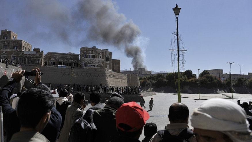 Smoke rises after an explosion at the Defense Ministry complex in Sanaa, Yemen, Thursday, Dec. 5, 2013. Military and hospital officials in Yemen said a large explosion at the Defense Ministry complex in the center of the capital, Sanaa, has wounded tens of people, many of them seriously. (AP Photo/Mohammed Hamoud)