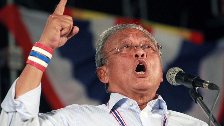 Thai protest leader Suthep Thuagsuban gestures as he addresses his supporters during an anti-government rally at the government complex in Bangkok, Thailand, Friday, Dec. 6, 2013. The truce between Thailand's political rivals held in Bangkok on Friday, amid more ceremonies in honor of the king's birthday, while the leader of the protest movement who has vowed to overthrow the government planned to announce his next move. (AP Photo/Wason Wanichakorn)