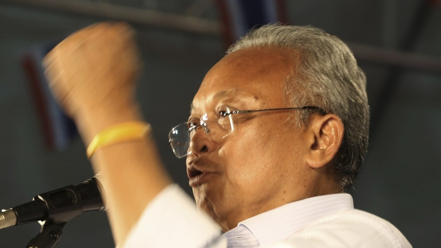 Thai protest leader Suthep Thuagsuban gestures as he addresses his supporters during an anti-government rally at the government complex in Bangkok, Thailand, Friday, Dec. 6, 2013. The truce between Thailand's political rivals held in Bangkok on Friday amid more ceremonies in honor of the king's birthday, while the leader of the protest movement who has vowed to overthrow the government planned to announce his next move. (AP Photo/Apichart Weerawong)