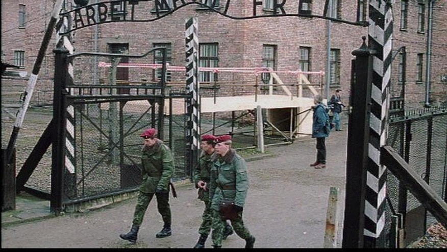 """FILE photo of the gate at Auschwitz, former Nazi concentration camp, with slogan """"Work Makes You Free.""""  A 94-year-old man who was deported from the U.S. for lying about his Nazi past was ordered released from custody after a German court said it has """"serious doubts"""" that he is fit to stand trial on charges he served as an Auschwitz death camp guard."""