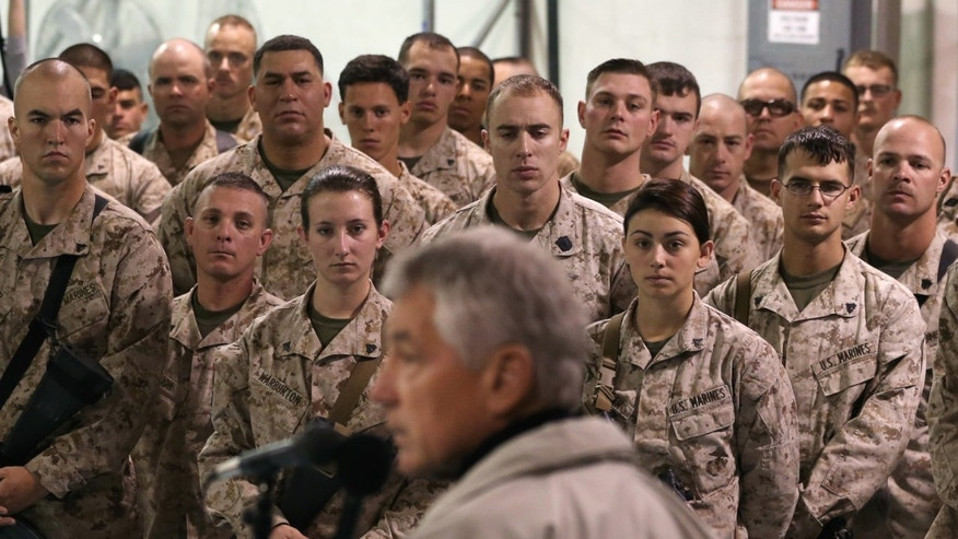 U.S. troops listen to U.S. Secretary of Defense Chuck Hagel at Camp Bastion, Afghanistan, Sunday, Dec. 8, 2013. Hagel spoke with troops and thanked them for being deployed for the holidays. (AP Photo/Mark Wilson, Pool)
