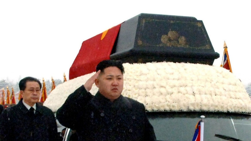 """FILE - In this Dec. 28, 2011 file photo, North Korea's leader, Kim Jong Un, front center, is followed by his uncle Jang Song Thaek, vice chairman of the National Defense Commission, as he salutes beside the hearse carrying the body of his late father North Korean leader Kim Jong Il during the funeral procession in Pyongyang, North Korea. North Korea on Monday, Dec. 9, 2013, acknowledged the purge of leader Kim Jong Un's influential uncle for alleged corruption, drug use, gambling and a long list of other """"anti-state"""" acts, apparently ending the career of the country's second most powerful official. The young North Korean leader will now rule without the relative long considered his mentor as he consolidated power after the death of his father, Kim Jong Il, two years ago. (AP Photo/Kyodo News, File) JAPAN OUT, MANDATORY CREDIT"""