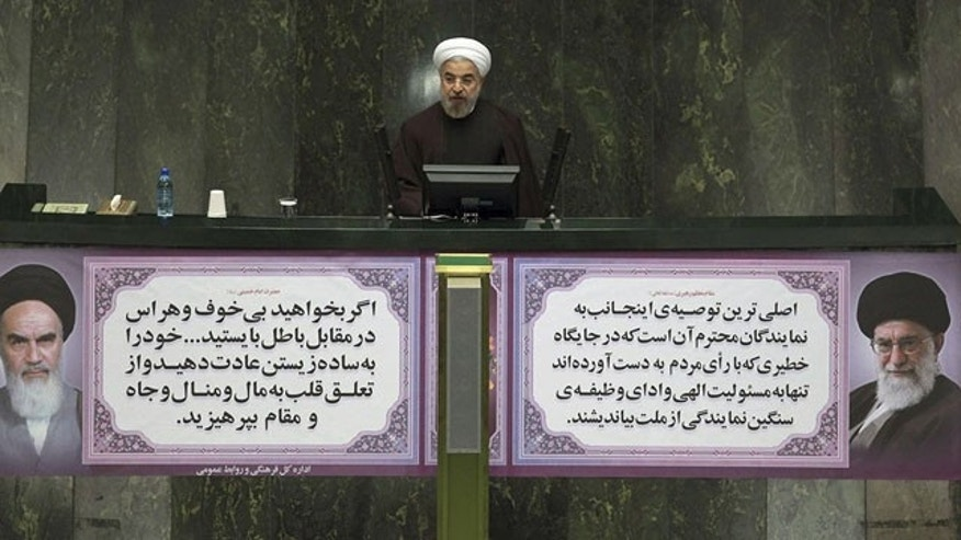 December 8, 2013: Iran President Hassan Rouhani speaks on next year's budget bill in an open session of parliament in Tehran. Rouhani said Sunday that last month's nuclear deal with world powers has already boosted the country's economy, as he continues a push to convince skeptics of the benefits brought by the pact's partial sanctions relief. (AP Photo/Presidency Office)