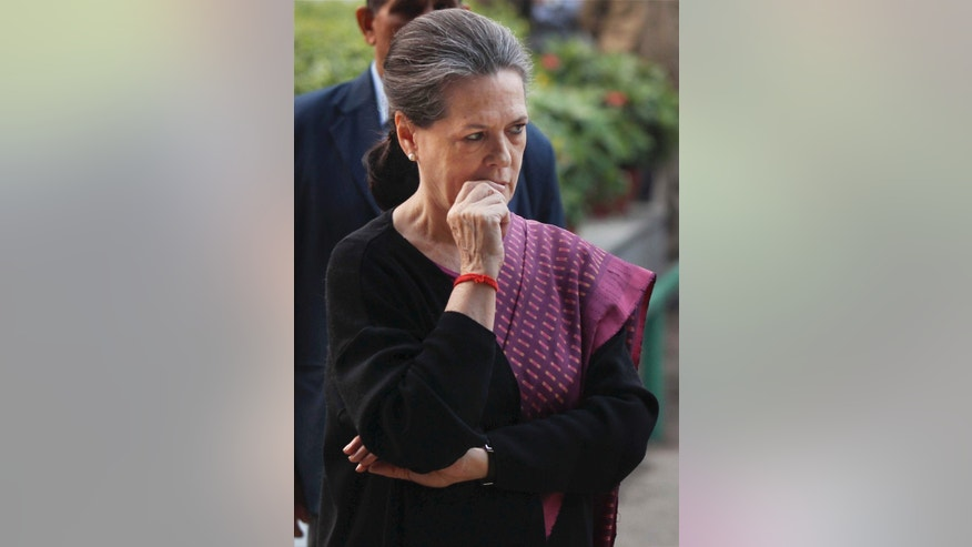 India's ruling Congress party president Sonia Gandhi reacts after addressing the media in New Delhi, India, Sunday, Dec. 8, 2013. India's main Hindu nationalist party appeared to make strong electoral gains in four heartland states Sunday, sidelining the ruling Congress party in a race seen as a test before next year's general election, according to preliminary results. (AP Photo)