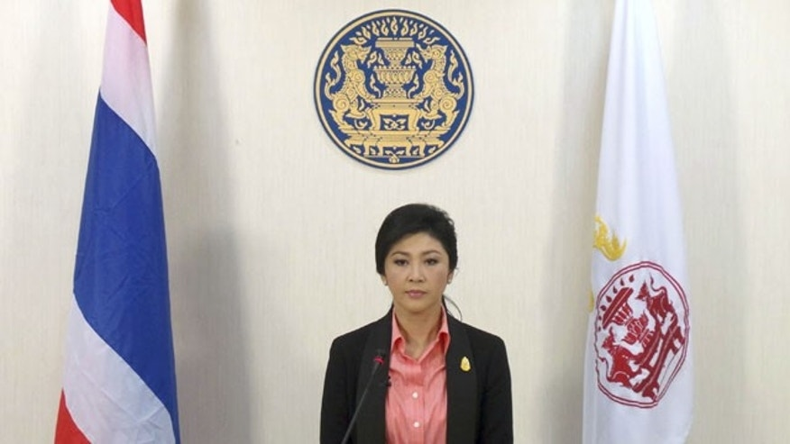 December 9, 2013: In this photo released by the Thai Spokesman Office, Thai Prime Minister Yingluck Shinawatra speaks on Thai TV pool in Bangkok. Yingluck said that she will dissolve the lower house of Parliament and call elections to calm the country's deepening political crisis. (AP Photo/Thai Spokesman Office)