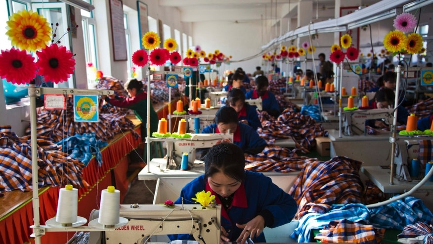 In this Saturday, Nov. 9, 2013 photo, North Korean seamstresses work at sewing machines at the Sonbong Textile Factory in Sonbong, North Korea, inside the Rason Special Economic Zone. Last month, North Korea announced plans to create economic zones in every province. The North also recently laid out new laws to facilitate foreign tourism and investment. The laws provide investors with special incentives and guarantees, while giving local leaders greater autonomy to promote themselves and handle business decisions. (AP Photo/David Guttenfelder)