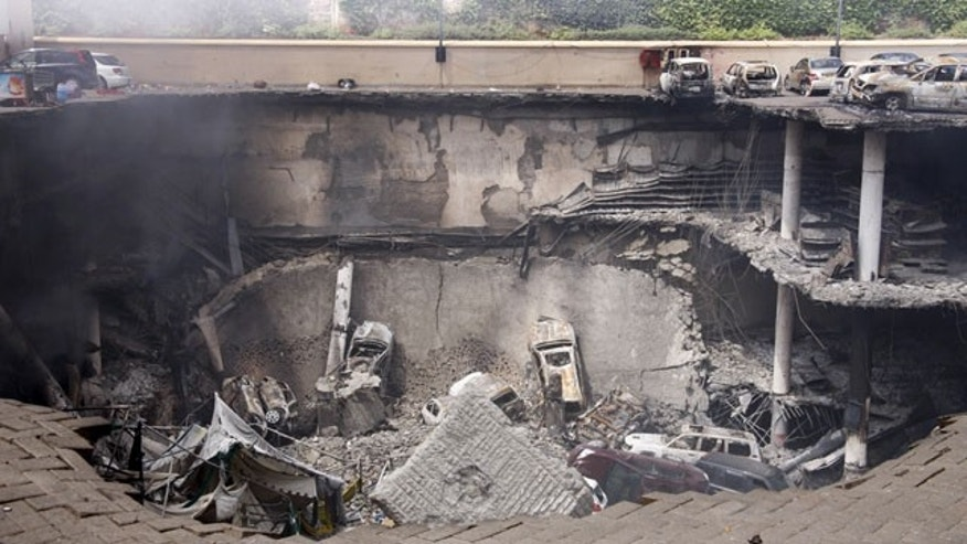 September 26, 2013: This photo released by the Kenya Presidency shows the collapsed upper car park of the Westgate Mall in Nairobi, Kenya. (AP Photo/Kenya Presidency, File)