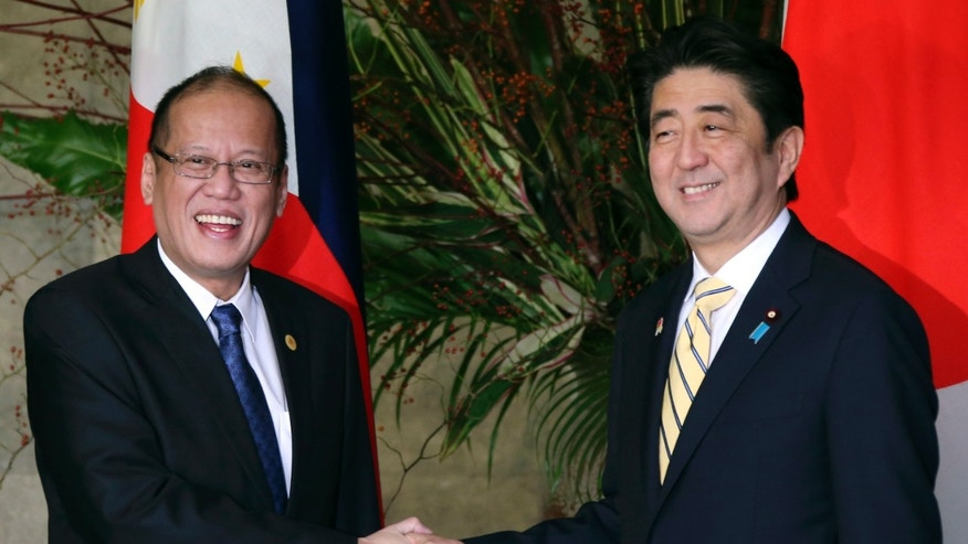 Japanese Prime Minister Shinzo Abe, right, shakes hands with Philippine President Benigno Aquino III prior to their working lunch at Abe's official residence in Tokyo, Friday, Dec. 13, 2013. Aquino is in Tokyo to attend meetings between Japanese and ASEAN leaders. (AP Photo/Koji Sasahara, Pool)