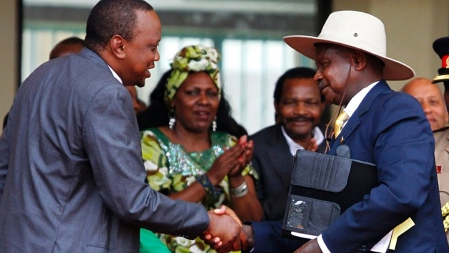 Dec. 12, 2013: Kenyan President Uhuru Kenyatta welcomes Uganda's President Yoweri Museveni, right, as Kenya celebrates 50 years of independence at Moi International Sports Complex Kasarani, Nairobi, Kenya.