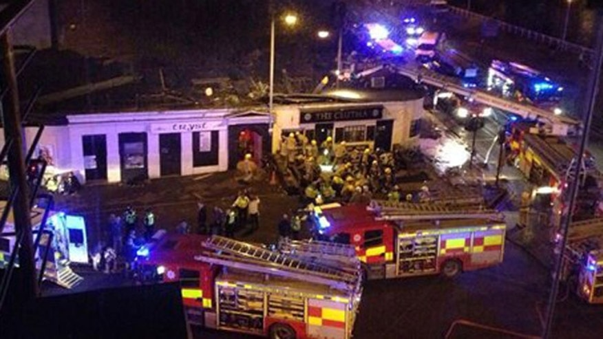 Nov. 29, 2013: Picture taken with permission from Jan Hollands Twitter feed  of the helicopter crash at the Clutha Bar in Glasgow. (AP)