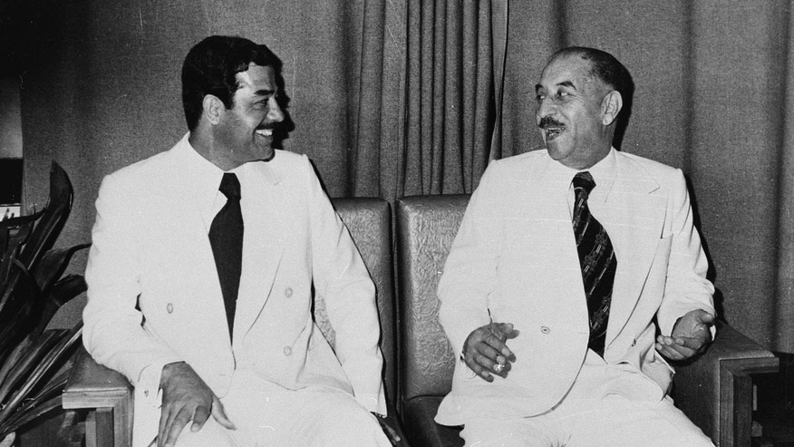 FILE - In this Nov.1978 file photo, then Iraqi President Ahmed Hassan el Bakr, right, and Saddam Hussein are pictured in Baghdad. North Korea's execution of Kim Jong-un's uncle suggests that the boyish leader has learned to wield their realpolitik playbook, ridding himself of one would-be rival and sowing fear among others who might challenge him. Stalin, Hitler and other of the 20th century's most notorious dictators, methodically ousted opponents to brazenly seize and consolidate power. (AP Photo/file)