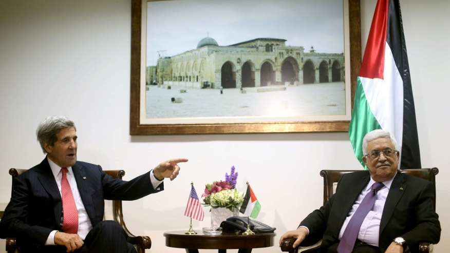 Palestinian President Mahmoud Abbas, right, meets with U.S. Secretary of State John Kerry in the West Bank city of Ramallah on Thursday, Dec. 12, 2013. Continuing a furious pace of shuttle diplomacy aimed at securing an elusive Israeli-Palestinian peace deal by spring, U.S. Secretary of State John Kerry arrived in the Middle East on Thursday on his ninth trip of the year. In closed-door talks with Palestinian President Mahmoud Abbas and Israeli Prime Minister Benjamin Netanyahu on Thursday and Friday, Kerry will be following up on elements of a West Bank security plan, ideas which he unveiled on his most recent visit to the region just last week, and other points of potential progress. Kerry's latest visit comes amid Palestinian unhappiness with the security plan and few, if any, tangible signs of progress.(AP Photo/Fadi Arouri, Pool)