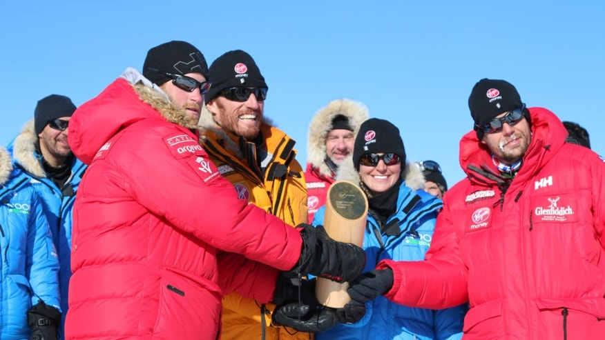 Dec. 13, 2013 - Prince Harry (left) with  fellow adventurers after reaching the South Pole, as part of their Walking With The Wounded charity trek. After more than three weeks pulling sleds across the frozen wastes of Antarctica the group stood at the bottom of the world.. (AP Photo/Walking with the Wounded, Victoria Nicholson)
