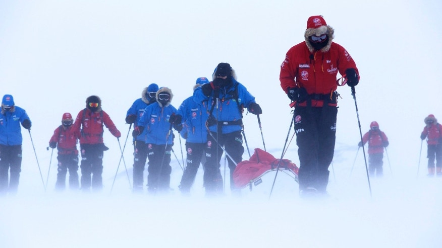 Undated photo shows Britain's Prince Harry, right, during training near Novo, Antarctica, ahead of an Antarctic charity race. Organizers of the race suspended the competition due to harsh conditions but plan to continue the journey to the South Pole. Harry is a member of 1 of 3 teams involving injured soldiers that set off on the 200-mile Walking with the Wounded South Pole Challenge.