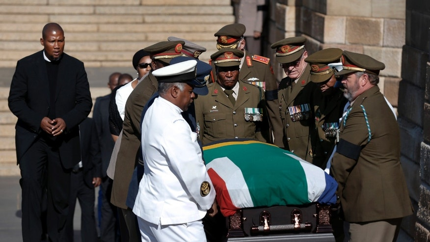 The casket of former South African President Nelson Mandela is followed by his oldest grandson Mandla Mandela, left, as it is carried to lie in state for the third and final day, for mourners to pay their respects at the Union Buildings in Pretoria, South Africa, Friday, Dec. 13, 2013. (AP Photo/Matt Dunham, Pool)