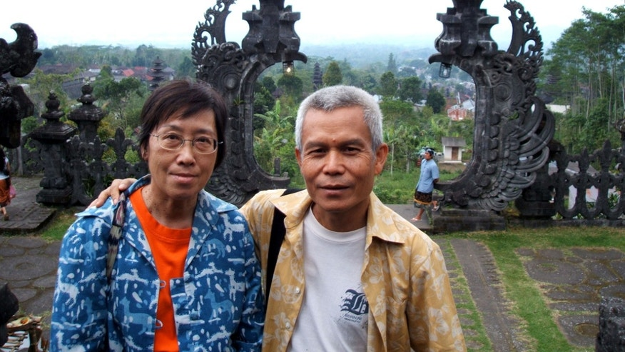 In this Sept. 16, 2005 photo given to Associated Press by Sombath Somphone family, Lao leading civil rights activist Sombath Somphone, right, with his wife Shui-Meng poses for a photograph during their holiday trip in Bali, Indonesia. The kidnapping of Sombath Somphone, the country's leading civil rights activist, has revealed the one-party communist Laos, one of the five such regimes in the world, as one of Asia's most repressive societies.  Yet, the country has maintained an image among tourists as a laid-back country of smiles. (AP Photo/Family Photo of Sombath Somphone)