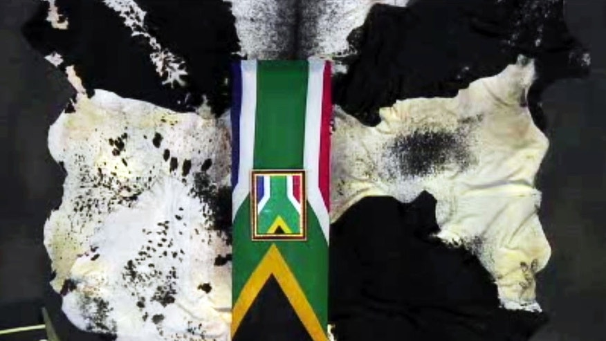 This frame grab APTN shows an overhead shot of former South African president Nelson Mandela's casket during his funeral service Sunday, Dec. 15, 2013, in Qunu, South Africa. (AP Photo/APTN)