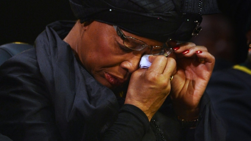 Nelson Mandela's widow Graca Machel wipes her eyes during the funeral service for former South African President Nelson Mandela in Qunu, South Africa, Sunday, December 15, 2013. (AP Photo/Odd Andersen, Pool)