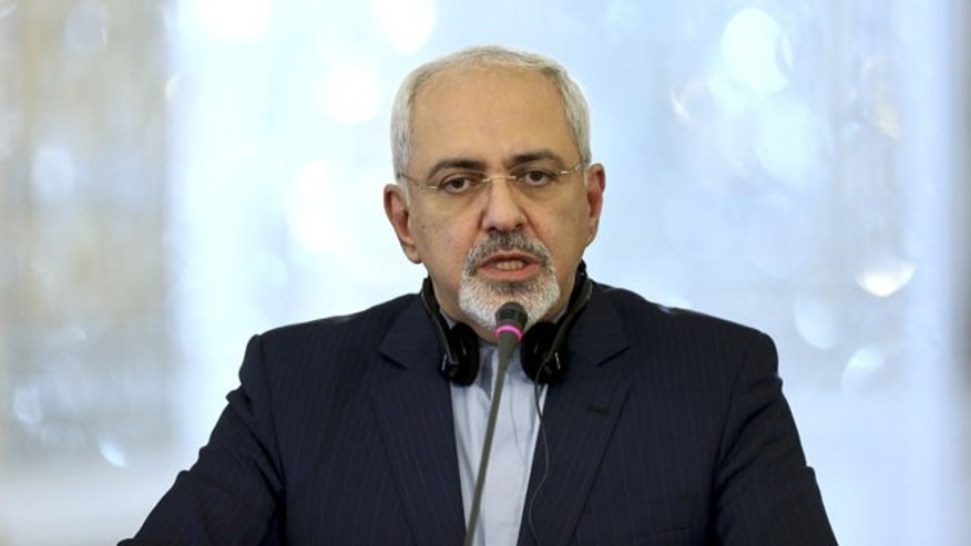 December 11, 2013: Iran's Foreign Minister Mohammad Javad Zarif holds a joint press conference with his Russian counterpart Sergey Lavrov in Tehran, Iran. (AP Photo)